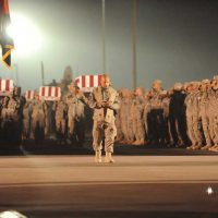 A ramp ceremony honors eight fallen soldiers of the 5th Stryker Brigade Combat Team (SBCT), held at Kandahar Airfield on October 28, 2009 as they are loaded onto a USAF C-17 Globemaster III destined for the unit's home in Fort Lewis, Washington. The soldiers were killed on October 27, 2009, in two separate improvised explosive device attacks in the Kandahar Region. (USAF Photo By Tech. Sgt. Francisco V. Govea II)(Released, Lt Col. John Bryan, AFPAA Public Affairs Officer, Pentagon)