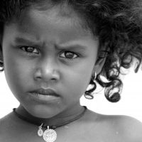 This little girl lost most her family in the 2004 South East Asian Tsunami. The photo was taken by the ocean only a couple weeks after while this little girl was still looking towards the open water as if she was waiting for her mother and siblings to return. She looks like an amazing strong soul..Because I think its one of the most beautiful and expressive faces I have ever seen.