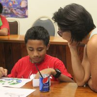 Artist Noe Tanigawa leads a Youth Mosaic workshop for students from George P. Harris and Koror Elementary schools.