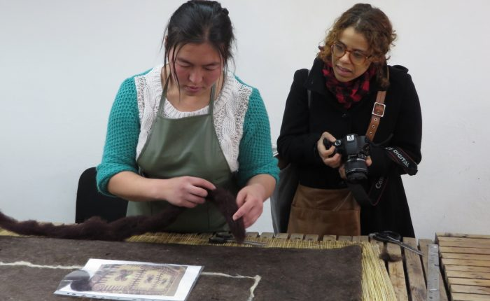 Alexis at her workshop with the Tumar Art Group looking at felt production.
