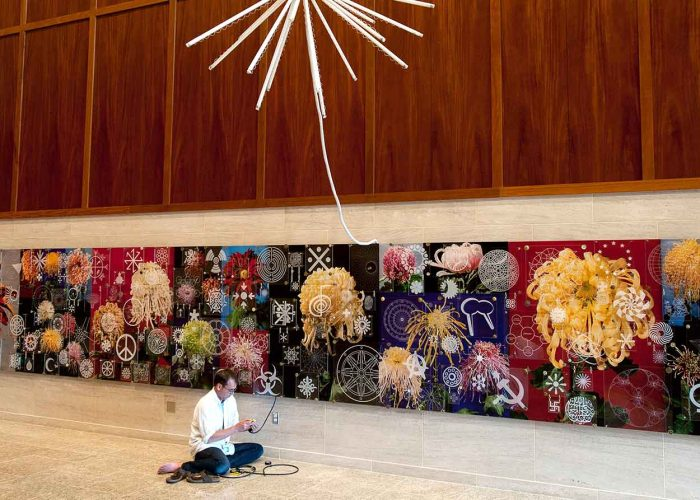Thomas Glassford installing his work in Tijuana