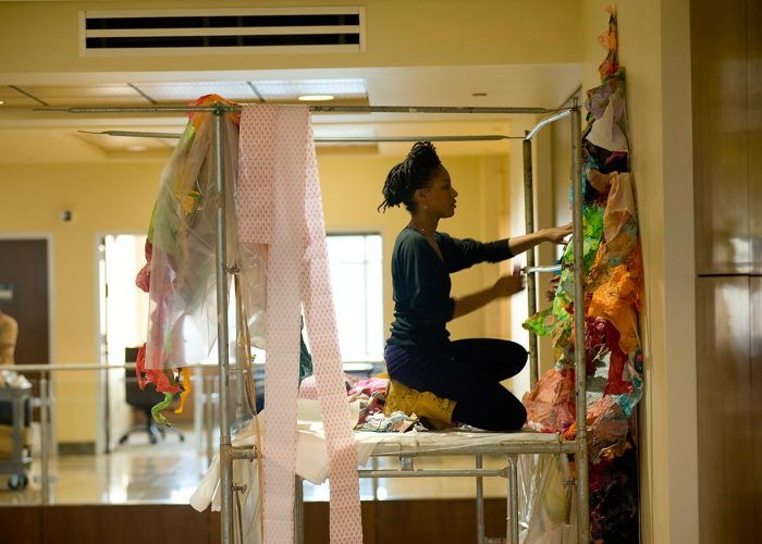 Maya Asante installing her work in the U.S. Embassy Antananarivo